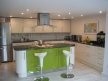 Contemporary high gloss kitchen with stunning polished granite worktop.
