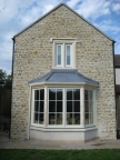 Forming a new bay window and new stone mullion window above brings character to the gable end.