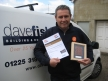 Dave with his Building Excellence Award plaque and certificate.